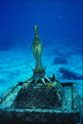 The statue of the Virgin with the metal under the water